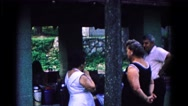1963: three adults have gathered at an outside venue to socialize  Stock Footage