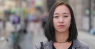 Young Asian woman in city serious face portrait close up Stock Footage