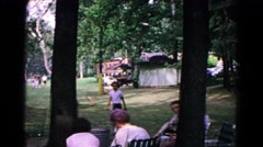 1963: a child walks through a small park between some trees. COLD SPRINGS Stock Footage