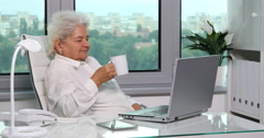 Old Woman Happiness Relaxation Drinking Hot Coffee in Workplace Office Interior Stock Footage