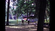 1963: walking through the park COLD SPRINGS, NEW YORK Stock Footage