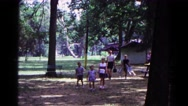 1963: a family arriving at a park with chairs, food and blankets  Stock Footage