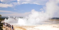 Tourists Watching Geysers Erupting in Yellowstone National Park, Wyoming Stock Footage