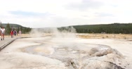 Tourists Walking Past Geysers in Yellowstone National Park, Wyoming Stock Footage