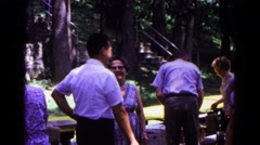 1963: attendees at an outdoor gathering hug and shake hands COLD SPRINGS Stock Footage
