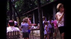 1963: kids of the neighborhood enjoy a beautiful day at a local block party  Stock Footage