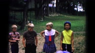 1963: children are seen having fun in a garden area COLD SPRINGS, NEW YORK Stock Footage