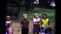 1963: boys and girls on a playground blowing bubble gum bubbles COLD SPRINGS Stock Footage
