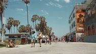 Venice Beach Boardwalk: People Walking in Slow Motion 2 Stock Footage