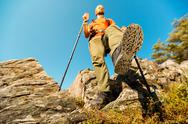 Concept, Young male with beard is traveling through the mountain, tourist Stock Photos