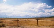 Grand Teton's Time Lapse: Clouds, Mountains & Golden Plains of Wyoming Stock Footage