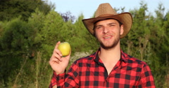 Optimistic Gardener Man in Bio Orchard Presentation and Talking About Gold Apple Stock Footage