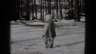 1948: little girl walking in the snow MIDDLETOWN PENNSYLVANIA Stock Footage