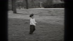1948: happy kid with hat running through the ground in the park MIDDLETOWN Stock Footage