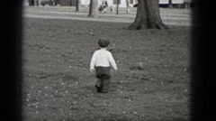 1948: little boy chases pigeons in the park MIDDLETOWN PENNSYLVANIA Stock Footage