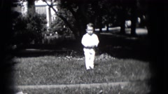 1948: boy enjoying the outdoor play with fun and joy  Stock Footage