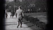 1948: people are seen in a tourist area and are observing a building MIDDLETOWN Stock Footage