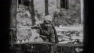 1948: a bundled child playing in the snow outside in the front yard MIDDLETOWN Stock Footage
