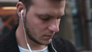 Young adult listening to music Stock Footage