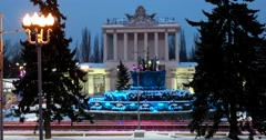Sleep fountain in the snow, playing evening illumination, spruce Stock Footage
