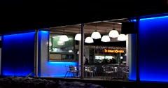 Attractive coffee shop in winter, multi-colored illumination, visitors Stock Footage