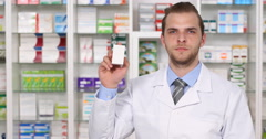 Confident American Pharmaceutist Man Showing Medicine Drug Healthcare Product  Stock Footage