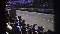 1955: race cars slowly pass by audience one by one in course lane LE MANS  Stock Footage