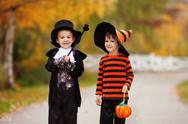 Two boys in the park with Halloween costumes Stock Photos
