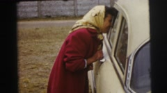 1955: lady questions driver in car LE MANS GRAND PRIX, FRANCE Stock Footage