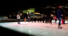 Ice skating rink at ENEA, evening lights, visitors may skate in a circle Stock Footage