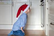 Curious little boy, watching ginger bread cookies in the oven Stock Photos