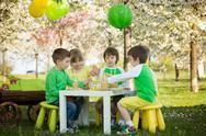 Happy sweet preschool children, celebrating fifth birthday of cute boy Stock Photos