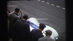 1955: white race car driving onto course while onlookers observe LE MANS  Stock Footage