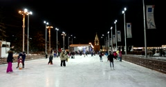 Adults and small children learn to skate on the ice rink Stock Footage