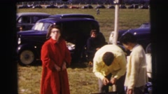 1955: woman in red coat pumps air near vintage cars LE MANS GRAND PRIX, FRANCE Stock Footage