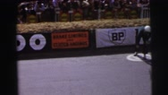 1955: race car drivers racing to their cars and then racing on a track LE MANS Stock Footage