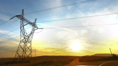 Drive toward Sunset with Power Lines and High-voltage tower Pylon Stock Footage