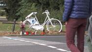 A ghost bike roadside memorial on the corner of a crossroads Stock Footage