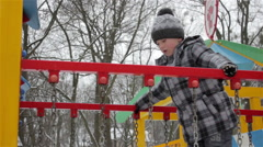 Go to children's swing in winter Stock Footage