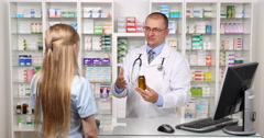 Pharmacy Specialist Giving Medicine Advice Talking Young Woman Client Get Help Stock Footage