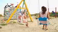 Mom and daughter on a swing Stock Footage