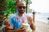 Man drinking coconut Stock Photos