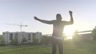 Happy Man Dancing And Singing In City Park At Sunset Stock Footage