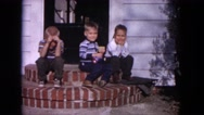 1964: siblings are seen playing outdoor and posing EVANSTON, ILLINOIS Stock Footage