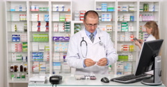 Pharmacist Man and Woman Team Work Drugstore Pills Drugs Inventory Collaboration Stock Footage