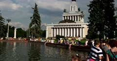 The Central pavilion, people bathe feet in the fountain at ENEA Stock Footage