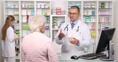 Old Woman Get Info Drugstore Specialist Explaining Recommending Medicine Product Stock Footage