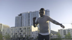 Carefree Man Sings And Dances In City Park Stock Footage