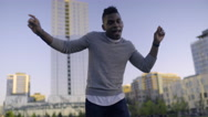 Happy Man Sings And Dances In City Park Stock Footage