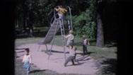1964: children are seen having fun in a garden area EVANSTON, ILLINOIS Stock Footage